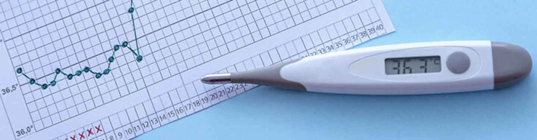 Kurvengrafik und Thermometer